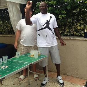 Michael Jordan plays beer pong