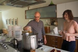 Joe and Lauren Grimm brew test batches in their kitchen.